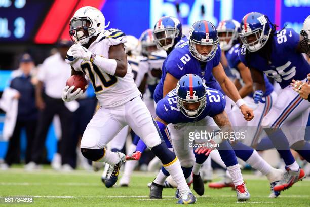 Desmond King of the Los Angeles Chargers attempts to break past Darian Thompson of the New York Giants on the kickoff during an NFL game at MetLife...