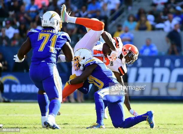 Desmond King of the Los Angeles Chargers hits Josh Gordon of the Cleveland Browns during the second quarter of the game at StubHub Center on December...