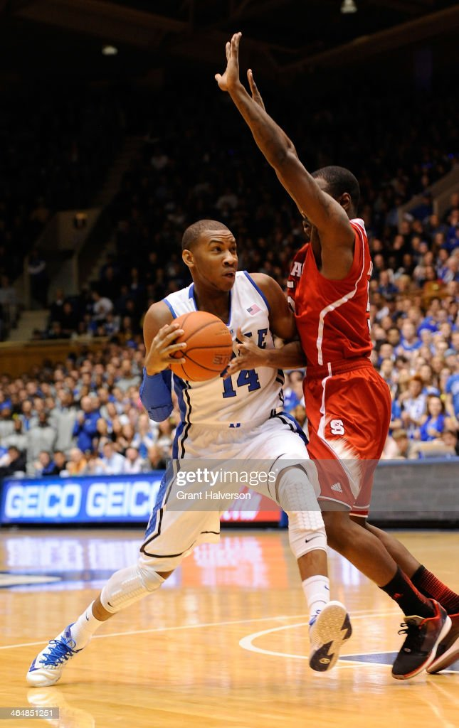 Desmond Lee #5 of the North Carolina State Wolfpack defends a drive by <a gi-track='captionPersonalityLinkClicked' href=/galleries/search?phrase=Rasheed+Sulaimon&family=editorial&specificpeople=7887134 ng-click='$event.stopPropagation()'>Rasheed Sulaimon</a> #14 of the Duke Blue Devils during their game at Cameron Indoor Stadium on January 18, 2014 in Durham, North Carolina. Duke won 95-60.