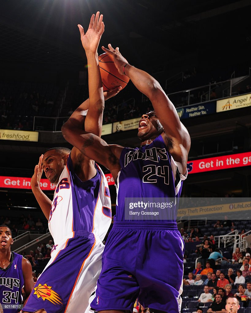 Desmond Mason of the Sacramento Kings puts a shot up around the block of Grant Hill of the Phoenix Suns in a preseason NBA game on October 20 2009 at...