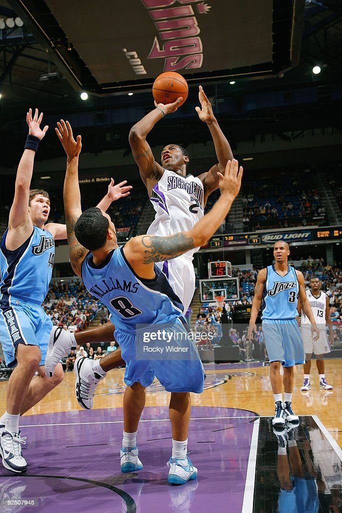 Desmond Mason of the Sacramento Kings puts up a shot against Deron Williams of the Utah Jazz during the preseason game on October 23 2009 at Arco...