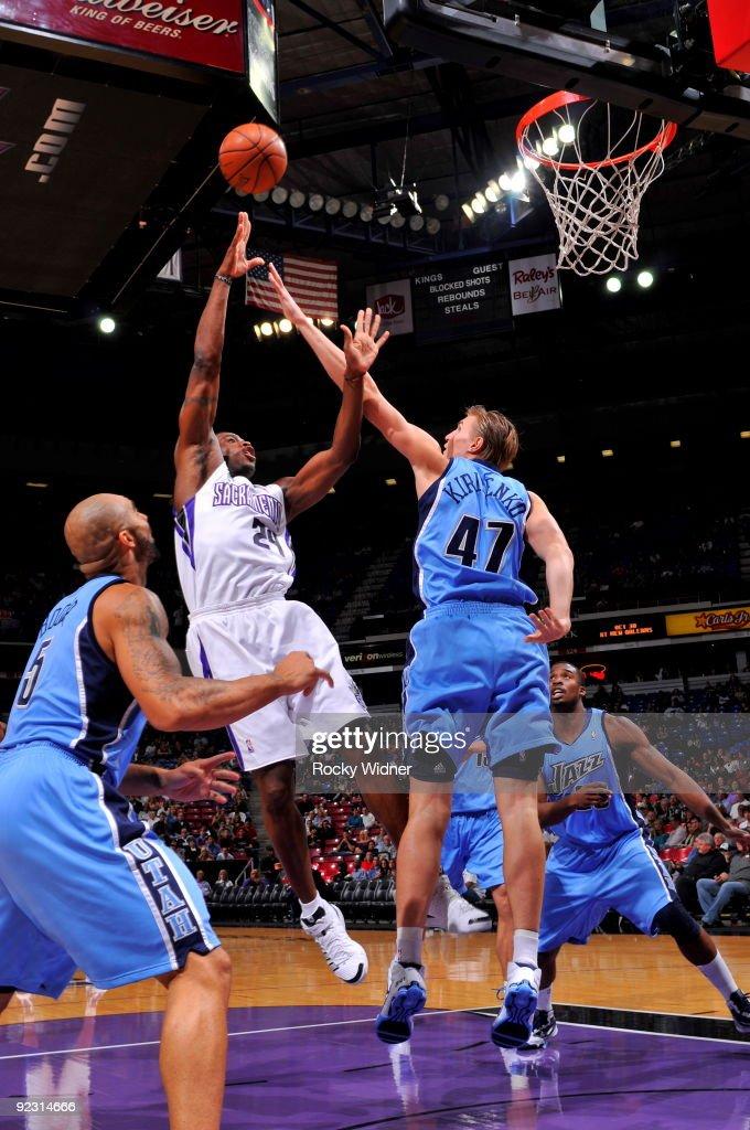 Desmond Mason of the Sacramento Kings shoots the ball over Andrei Kirilenko of the Utah Jazz during a preseason game on October 23 2009 at ARCO Arena...