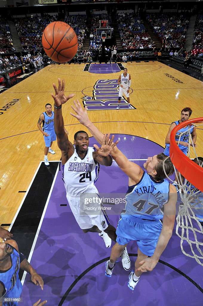 Desmond Mason of the Sacramento Kings takes the ball to the basket against Andrei Kirilenko of the Utah Jazz during a preseason game on October 23...