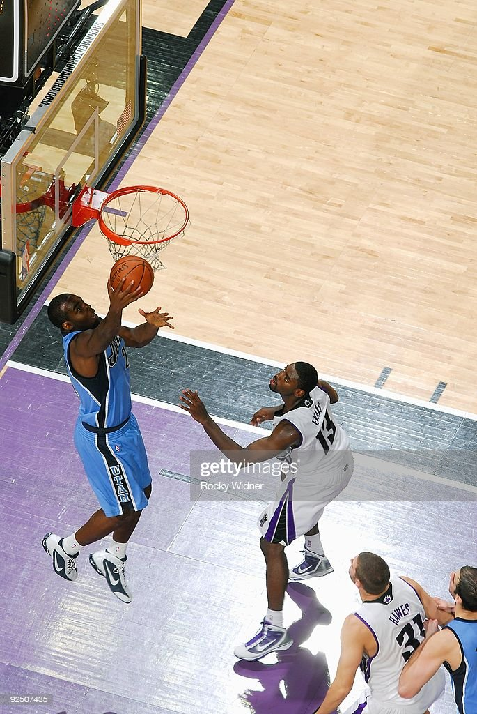 Desmond Mason of the Utah Jazz lays up a shot against Mehmet Okur of the Sacramento Kings during the preseason game on October 23 2009 at Arco Arena...