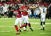 Desmond Trufant and Kroy Biermann of the Atlanta Falcons celebrate after a missed 4th quarter field goal by Cody Parkey of the Philadelphia Eagles at...