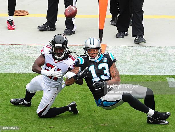 Desmond Trufant of the Atlanta Falcons breaks up a pass intended for Kelvin Benjamin of the Carolina Panthers at Bank Of America Stadium on November...