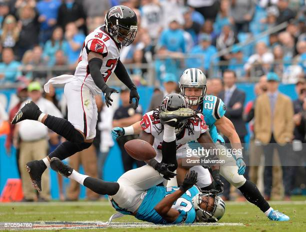 Desmond Trufant of the Atlanta Falcons breaks up a pass intended for Russell Shepard of the Carolina Panthers during their game at Bank of America...