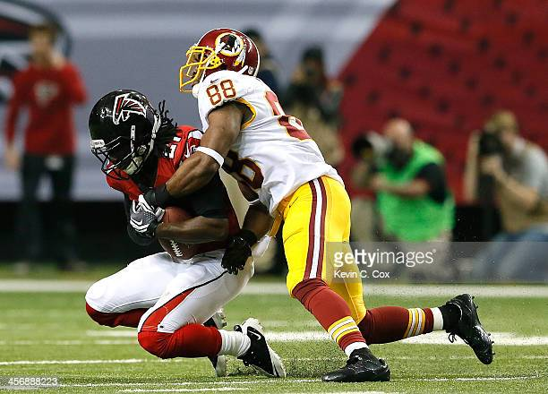 Desmond Trufant of the Atlanta Falcons intercepts a pass intended for Pierre Garcon of the Washington Redskins at Georgia Dome on December 15 2013 in...