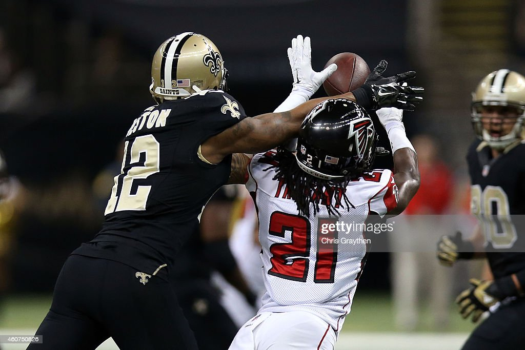 Desmond Trufant #21 of the Atlanta Falcons intercepts a pass intended for Marques Colston #12 of the New Orleans Saints during the first quarter of a gameat the Mercedes-Benz Superdome on December 21, 2014 in New Orleans, Louisiana.