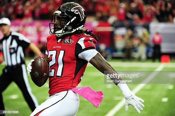 Desmond Trufant of the Atlanta Falcons returns a fumble for a touchdown in the first half against the Houston Texans at the Georgia Dome on October 4...