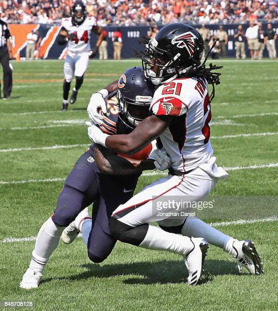 Desmond Trufant of the Atlanta Falcons tries to wrap up Tarik Cohen of the Chicago Bears during the season opening game at Soldier Field on September...