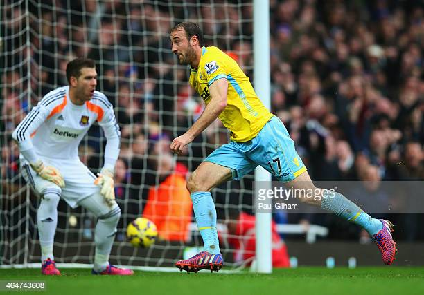 Despair for Adrian of West Ham United as Glenn Murray of Crystal Palace celebrates as he scores their third goal during the Barclays Premier League...