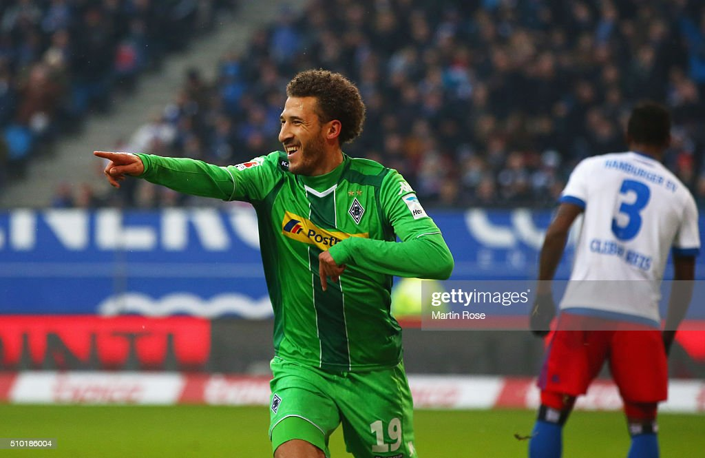 Despair for Cleber of SV Hamburg (3) as Fabian Johnson of Borussia Moenchengladbach celebrates as he scores their first goal during the Bundesliga match between Hamburger SV and Borussia Moenchengladbach at Volksparkstadion on February 14, 2016 in Hamburg, Germany.