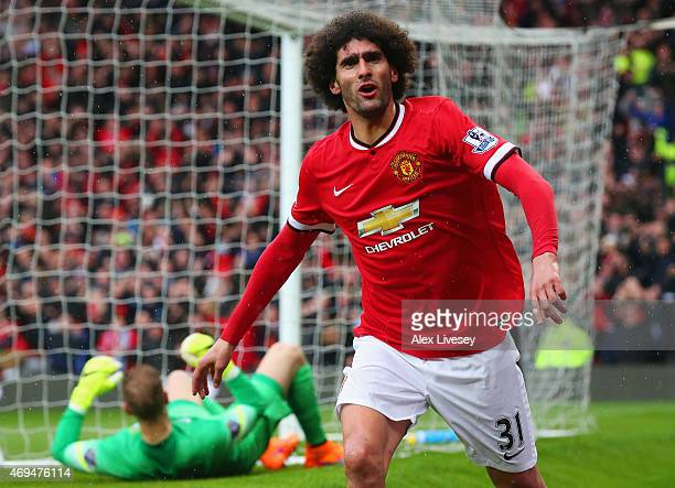 Despair for goalkeeper Joe Hart of Manchester City as Marouane Fellaini of Manchester United celebrates as he scores their second goal with a header...