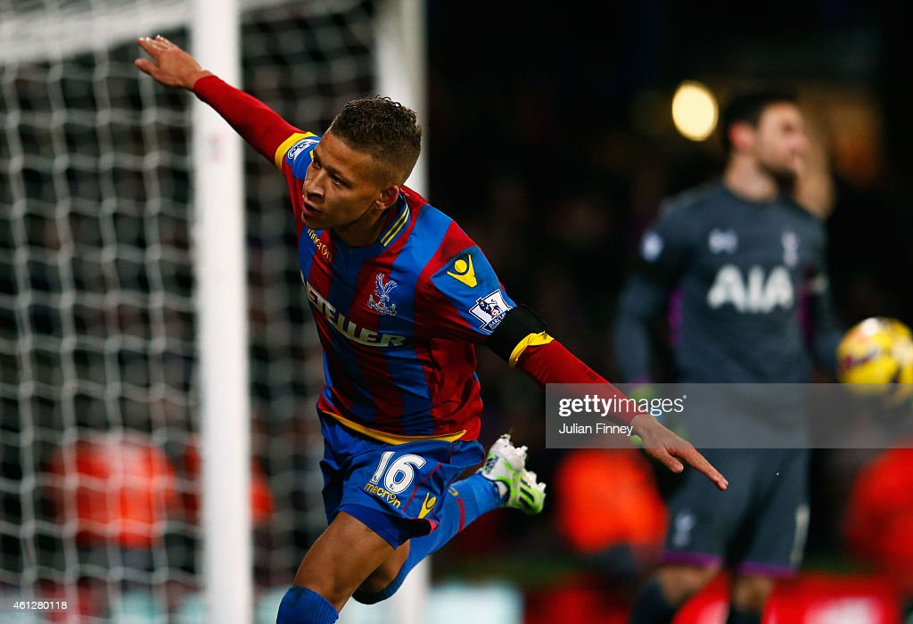 Despair for Hugo Lloris of Spurs (R) as Dwight Gayle of Crystal Palace celebrates scoring their first and equalisin goal from a penalty during the Barclays Premier League match between Crystal Palace and Tottenham Hotspur at Selhurst Park on January 10, 2015 in London, England.