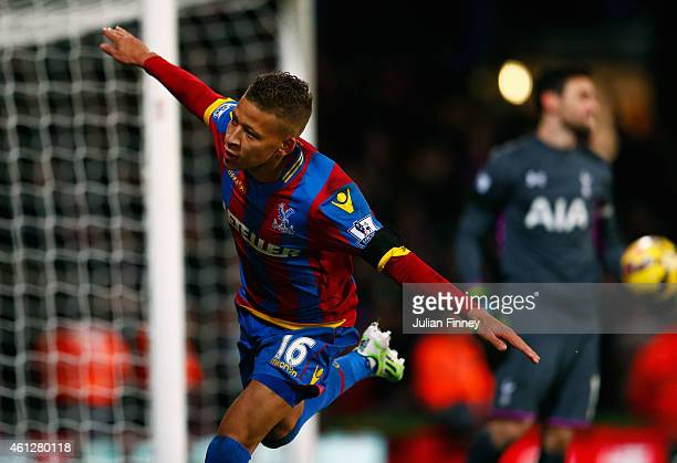 Despair for Hugo Lloris of Spurs as Dwight Gayle of Crystal Palace celebrates scoring their first and equalisin goal from a penalty during the...