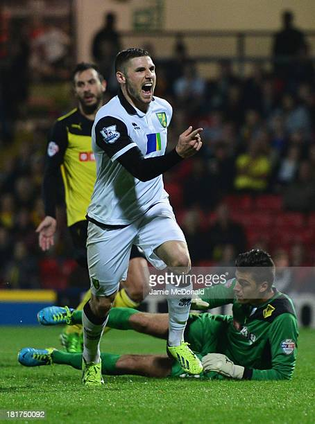 Despair for Jonathan Bond of Watford as Gary Hooper of Norwich City celebrates as he scoring their third goal during the Capital One Cup Third Round...