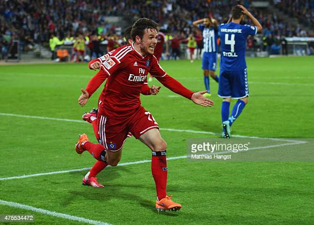 Despair for Karlsruher SC defenders as Nicolai Mueller of Hamburger SV celebrates as he scores their second goal during the Bundesliga playoff second...