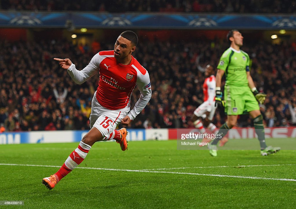 Despair for Silvio Proto of Anderlecht (R) as <a gi-track='captionPersonalityLinkClicked' href=/galleries/search?phrase=Alex+Oxlade-Chamberlain&family=editorial&specificpeople=7191518 ng-click='$event.stopPropagation()'>Alex Oxlade-Chamberlain</a> of Arsenal celebrates as he scores their third goal during the UEFA Champions League Group D match between Arsenal FC and RSC Anderlecht at Emirates Stadium on November 4, 2014 in London, United Kingdom.