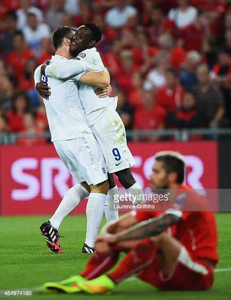 Despair for Valon Behrami of Switzerland as Danny Welbeck of England celebrates with Rickie Lambert as he scores their second goal during the UEFA...