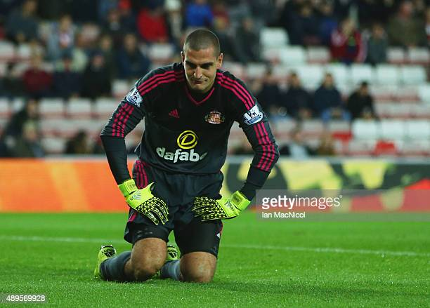 Despair for Vito Mannone of Sunderland as he scores an own goal for Manchester City's third goal during the Capital One Cup third round match between...