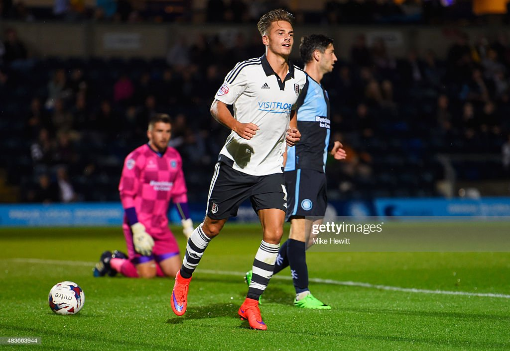 Despair for Wycomber players as Alex Kacaniklic of Fulham (C) celebrates as he scores their first goal during the Capital One Cup first round match between Wycombe Wanderers and Fulham at Adams Park on August 11, 2015 in High Wycombe, England.