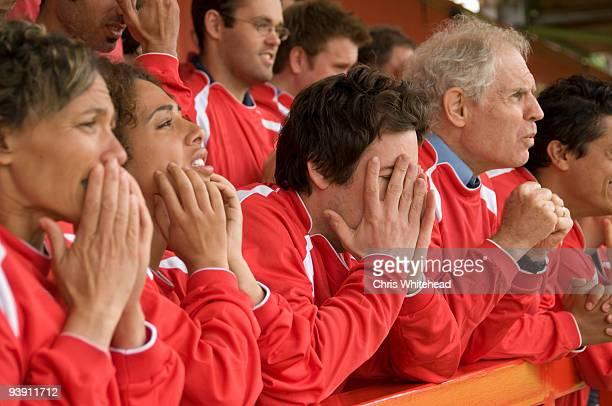Despairing fans at football match