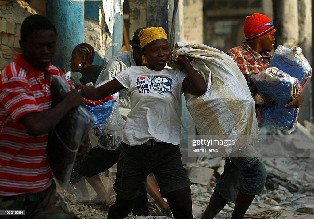 Desperate Haitians loot a damaged clothing store in PortauPrince Haiti that was shaken by a 61 aftershock Wednesday January 20 2010