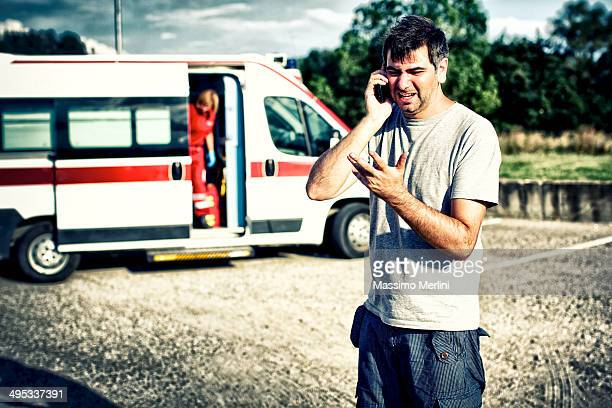Desperate man at phone after an accident