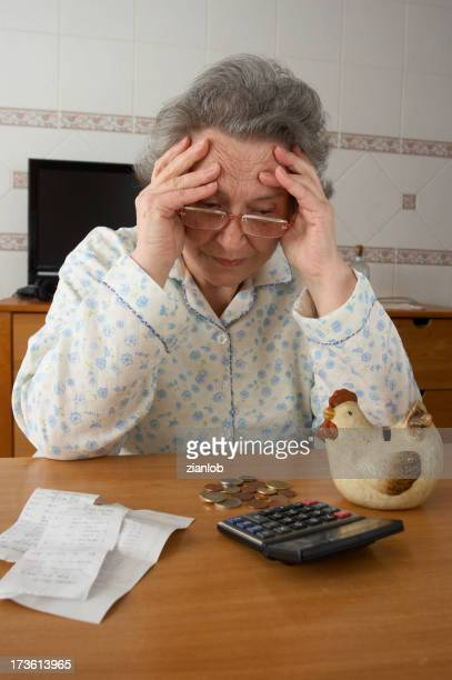 Desperate retired woman reviewing her savings.