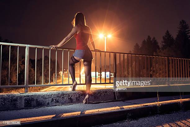 Desperate young woman standing on the bridge