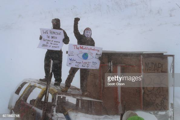 Despite blizzard conditions activists show support as military veterans march in support of the 'water protectors' at Oceti Sakowin Camp on the edge...