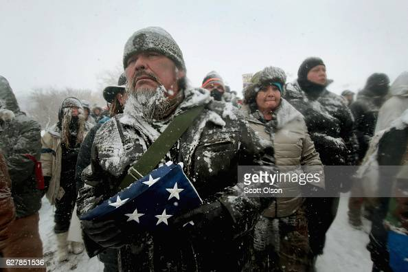 Despite blizzard conditions Erwin Begay a retired Army veteran from Black River Falls Wisconsin joined other military veterans in a march to in...