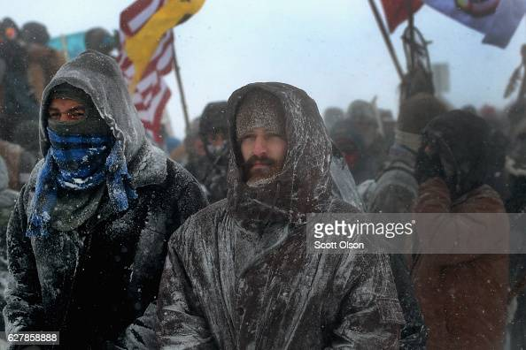 Despite blizzard conditions military veterans march in support of the 'water protectors' at Oceti Sakowin Camp on the edge of the Standing Rock Sioux...