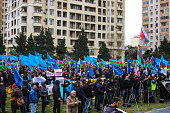 Despite the cold weather and strong winds thousands of people attend the rally at the stadium Mehsul in the Yasamal district of Baku demanding the...