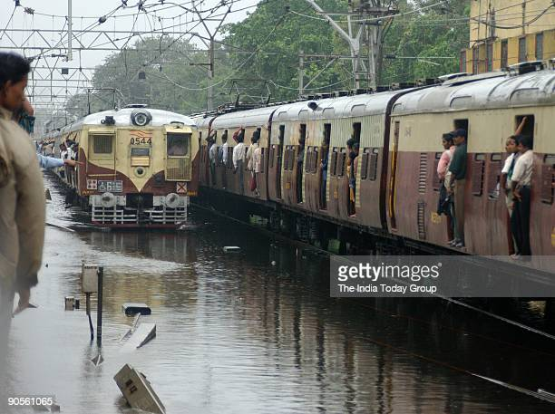 Despite the water logging in the track trains are moving very slowly in the western Line Water logging due to heavy down pour Mumbai Maharashtra India