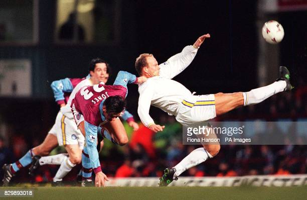 Despite West Ham's Steve Jones attention Leed's Robert Molenaar reaches the ball first during tonight's FA Carling Premiership match at Upton Park...