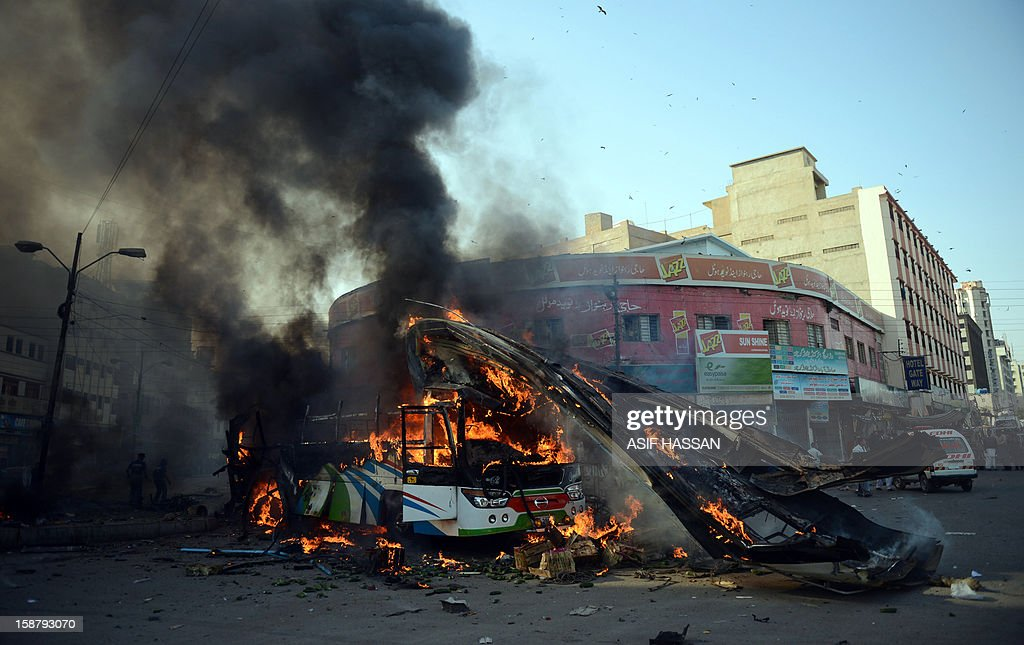 A desrtoyed passenger bus burns after an explosion in Pakistan's port city of Karachi on December 29, 2012. At least four people were killed and dozen wounded when a loud explosion ripped apart a passenger bus outside the railway station in the port city of Karachi, the nature of the explosion could not be ascertained. AFP PHOTO/Asif HASSAN