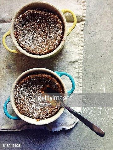 Dessert: Homemade baked gluten-free pumpkin custards in colourful ramekins : Stock Photo