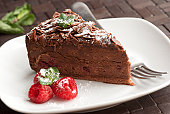 A piece of chocolate and raspberry torte on a plate
