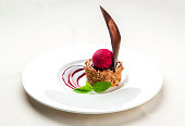 Delicious chocolate dessert with cherry ice-cream on a plate
