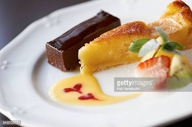 Dessert plate with chocolate slice and tart with sliced fruits