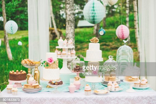 Dessert table with pretty cakes and cookies