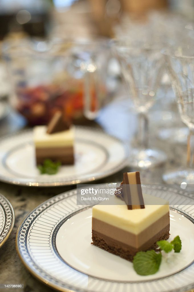 Desserts on plates at dinner party : Stock Photo