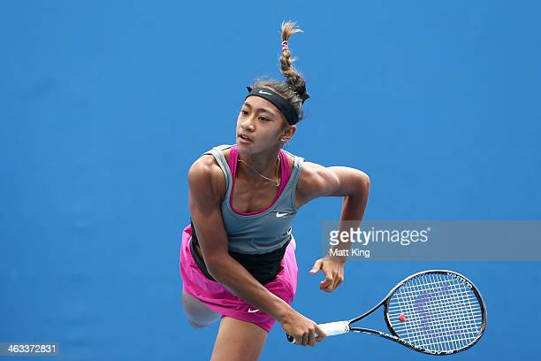 Destanee Aiava of Australia serves in her first round junior girls' match against Verena Hofer of Italy during the 2014 Australian Open Junior...