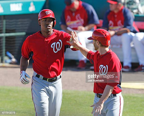 Destin Hood is congratulated by Mike Fontenot of the Washington Nationals after hitting a three run home run in the eighth inning against the St...