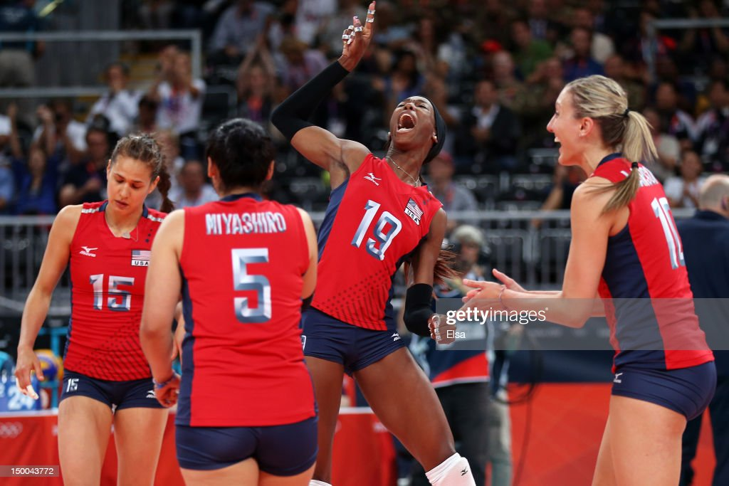 Destinee Hooker #19, Tamari Miyashiro #5, Logan Tom #15 and Jordan Larson #10 of United States celebrates after defeating Korea in the Women's Volleyball semifinal match on Day 13 of the London 2012 Olympics Games at Earls Court on August 9, 2012 in London, England.