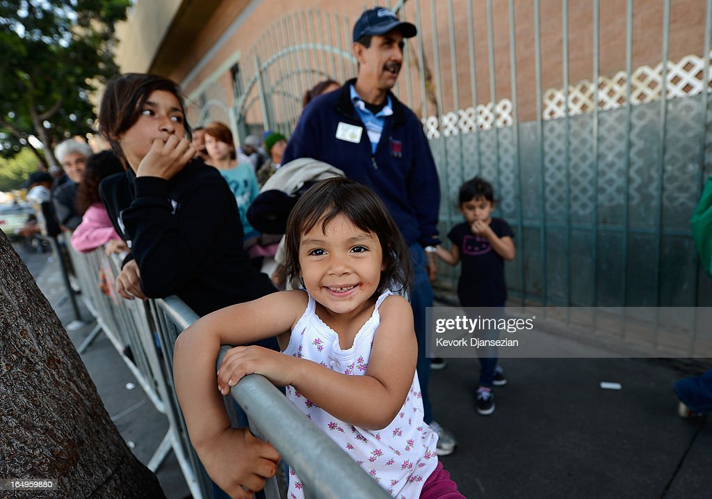 Destiny Barajas, 3, and her family wait in line for dinner on Good Friday during the Skid Row Easter event at the Los Angeles Mission on March 29, 2013 in Los Angeles, California. Volunteers, celebrities and nurses distributed more than 1000 Easter baskets to children and provided 3,500 hot meals, 2,000 pairs of shoes and and podiatric care to the homeless of Skid Row.