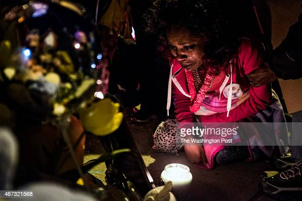 Destiny Barnes of DC attends a candlelight vigil for her daughter Dynesti Maraj who was struck Saturday by a car and killed in Bowie Maryland...