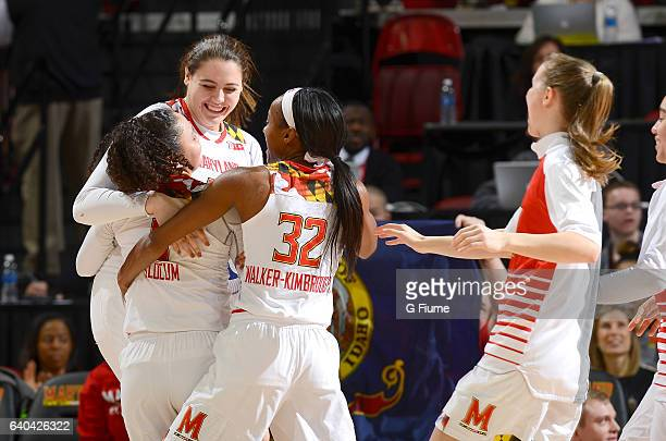Destiny Slocum of the Maryland Terrapins celebrates with teammates after scoring against the Iowa Hawkeyes at Xfinity Center on January 29 2017 in...